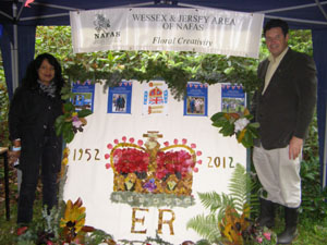 Mala Williams and Nigel Philpott with the 2012 Petal Fall Jubilee Collage