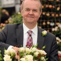 Ian Hislop with the new rose to honour Jane Austen
