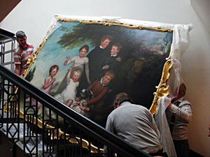 Painting being re-hung in the Guildhall 2 small